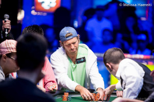 Layne Flack pushing in chips at a final table during the 2014 WSOP