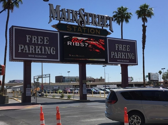 The massive surface parking lot across the street from Main Street Station Hotel & Casino in Las Vegas